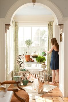 This is so great: arched doorway, moldings, patterned curtains, large plank floors, natural light.