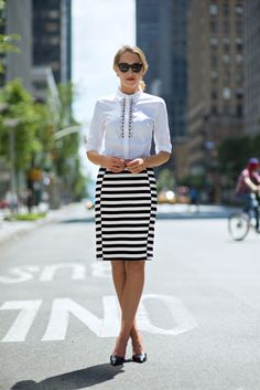 striped pencil skirt and white blouse with pumps