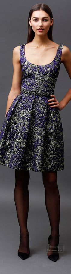Badgley Mischka.Pre-Fall 2015.  Brocade in a simple sleeveless dress.  Notice the embellished area at the waist, a subtle look of accessory that adds interest.