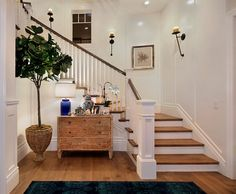 The entryway is casual and embraces coastal-themed decor.