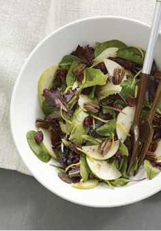 Mixed Greens & Pear Salad -- In this recipe, a mixed green salad tastes like a celebration when it's studded with pear slices, pecan halves and dried cranberries.