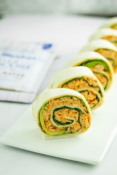 These spicy tuna pinwheels are the perfect bite-sized appetizer or snack. Layer the wraps with spinach and avocado, then add the filling and roll!