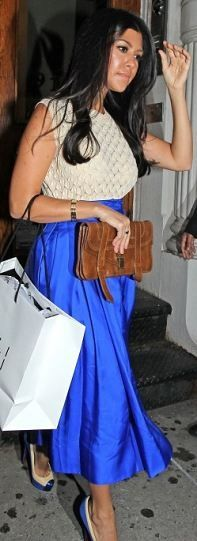 Who made Kourtney Kardashian's pumps, blue skirt, jewelry and brown buckle clutch that she wore in New York? Skirt – Rachel Roy  Shoes – Christian Louboutin  Purse – Proenza Schouler  Jewelry – Nissa