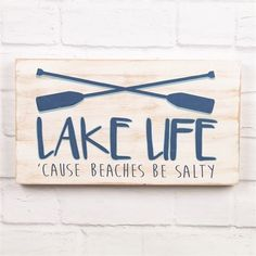Lake Life Wall Sign A charming wall sign for any lake home! Wood sign features witty lake saying and oar design.