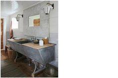 Repurposed old metal trough transformed into a very cool, unique bathroom vanity