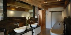 Project Portfolio: conversion of an ancient and important heritage Grade II* listed building in Bude, Cornwall. The Bazeley Partnership successfully gained planning permission for our client to restore, repair and convert the dilapidated barn into a stunning, contemporary family home. Winner of a Cornish Buildings Group Award 2015. Guest bathroom.