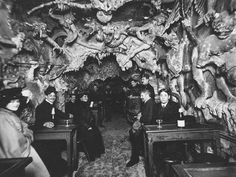 unexplained-events:  An old photo of a place called Hell's Cafe in Paris, which has since shut down.