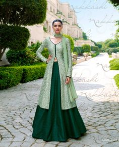 Green front slit Lehenga style suit with resham embroidery Green poly silk embroidered Lehenga style Resham embroidery with golden gotta border on Comes with matching santoon bottom and chiffon Can be stitched upto size 42 inches Indian Gowns, Indian Attire, Pakistani Dresses, Indian Wear, Indian Outfits, Long Choli Lehenga, Green Lehenga, Lehenga Choli Online, Silk Lehenga