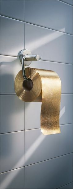 * 22-carat gold toilet paper. Australian company Toilet Paper Man produced a 3-ply roll paper made from 22-carat gold flakes through the roll. http://www.plushasia.com/media_photo/24942 #Home #Bathroom #gold