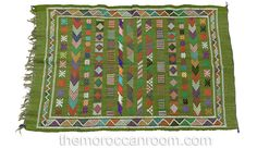Beautiful one-of-a-kind vintage Moroccan Berber Rug. Designs represent chin and ankle tattoos from the Berber tribes of the High Atlas Mountains of Morocco. The design and weaving motifs here act as tribal identity marks, believed to ward off evil and bring good luck. (Etsy, TresorsExotiques description)
