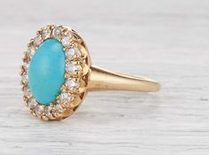 Antique Victorian Tiffany & Co. ring made in 14k yellow gold and centered with a cabochon turquoise. Accented with 16 single cut diamonds. Signed Tiffany & Co. Circa 1880. A beautiful Tiffany masterpiece featuring a vivid turquoise set in a traditional Victorian cluster design. Diamond and gold mining has caused devastation in areas such as Africa, wreaking havoc on delicate ecosystems and communities. Choosing to go vintage, you are eliminating the need for more mining and lessening the…