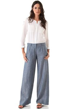 With flowy pants in a casual fabric, such as chambray, dial up the crisp-and-clean factor by pairing them with a timeless white shirt.     Jenni Kayne Wide Leg Trousers