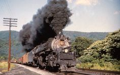 Baltimore & Ohio works hard as it muscles a mixed freight over Sand Patch Grade, circa early Baltimore And Ohio Railroad, Pennsylvania Railroad, Electric Locomotive, Steam Locomotive, Tarzan, Railroad History, Harpers Ferry, Train Times, Ohio River