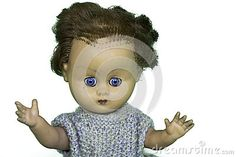 Old play doll with short hair and arms in the air