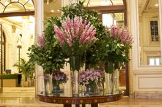 A simple statement piece at The Plaza Hotel this week. Alstroemeria, Larkspur, and Camellia Sinensis come together by the bountiful in a sweet combination of soft pinks and bold greens. Table Flower Arrangements, Large Floral Arrangements, Table Flowers, Flower Centerpieces, Plaza Hotel, Hotel Lobby, Fresh Flowers, Beautiful Flowers, Jeff Leatham