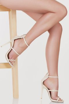 A stunning pair of heels that'll have your cat walk on point. Has two straps for detail and one for fit. Single zipper on back for closure. Patent leather finish. - Man made materials - Imported - Run