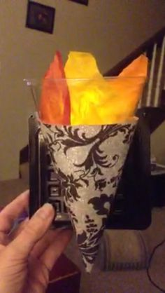 Wall sconces for our castle using fancy scrapbook paper as a cone, clear plastic cup, tissue paper with a small flame less candle, all attached to a recycled plastic square spray painted black! Yep...we're thrifty!