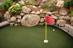 If you love golf, then you'll love the idea of a putting green in your backyard! Learn more about this amazing feature in our blog. #puttinggreen #landscapedesign #landscapingideas #landscaping #landscapers #twincities #outdoorinnovations