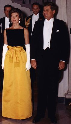 JACKIE. AND JACK. White House, 1961. Away to meet other 'famous ' people at a White House reception ( Einstein attending today ) Hence Jackie wore a special portable 'blackboard ' in case he had a eurica moment and just needed to get his chalk out to record his latest mathematical formula , well it could be a game changing idea from the greatest mind in history , (well one of the greatest genius minds at least ) So Jackie wasn't taking any chances and the dress worth millions on e bay then