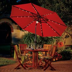 Light up your outdoor dining area with a 9-ft Solar Lighted Patio Umbrella.