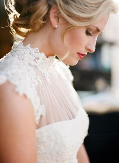 High sheer neckline, capped sleeves, and lace wedding dress. Looks beautiful on her.