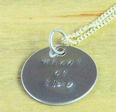 Wheel of Time Necklace - Robert Jordan Hand Stamped Jewellery - Aluminium Disc, Silver Lightning Bolt Shooting Star - Under 20 Dollars. £12.00, via Etsy.