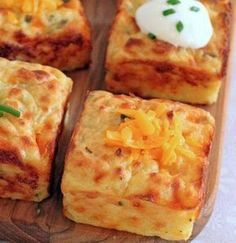 Ingredients: 3 cups of mashed potatoes 2 eggs 1/3 cup sour cream (optional extra for serving) 1 heaping cup shredded sharp cheddar cheese 2 tablespoons grated Parmesan 2 tablespoons chopped chives or parsley Salt and black pepper, to taste Directions: 1 – Preheat oven