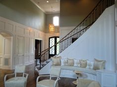 Image Design Stairs Custom curved staircase with wrought iron forged balusters, closed stringer system