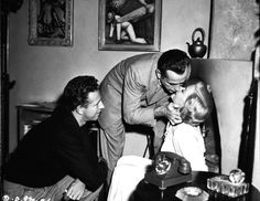 Director Nicholas Ray, Humphrey Bogart and Gloria Grahame rehearse a scene of In a Lonely Place