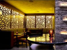 Back lit laser cut panels add interest and ambient light to this restaurant with windows only in the front.  The Alcove, at Rockwell Restaurant, Los Angeles, CA