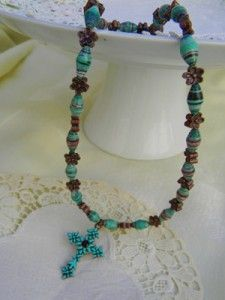 paper bead necklace formed into a cross. It would be cool if you made these out of church pamphlets.