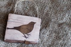 Mini Reclaimed Wood Sign- Bird. $5.00, via Etsy.