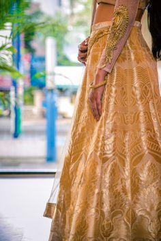 Bridal Details - Gold and Beige Banarsi Wedding Lehenga | WedMeGood | Banarsi Gold Lehenga with Embellished Gold Net Sleeve #wedmegood #lehenga #indianbride #indianwedding #banarsi #embellished #sleeves