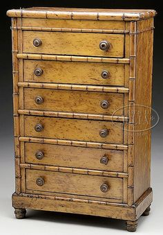 """RARE FAUX BAMBOO AND BIRDSEYE MAPLE MINIATURE SIX DRAWER CHEST. Mid 19th century, American. Fine example with well turned knobs and fine proportions. SIZE: 23-1/2"""" T x 14-3/4 W x 7-1/2"""" D."""