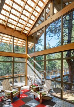 Cabin screened porch by Balance Associates Architects