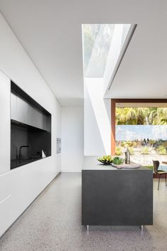 INSPIRATION: light plummeting into this sleek modern kitchen proves the value in opening up a home from all angles | est living