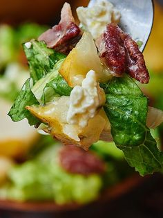 This pear, blue cheese, candied pecan salad has everything you're looking for in a salad. The crisp romaine pairs perfectly with the fresh, juicy pear, creamy blue cheese, sweet and crunchy pecans, and a tangy, sour dressing!