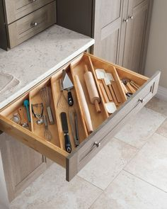 Angled drawer dividers make it easy to store longer utensils, like rolling pins…