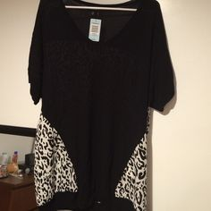Leopard print top from Torrid. Leopard print back and semi-front. Size 2. Knit: 100% rayon. Woven: 100% polyester. Never used. With tags. torrid Tops