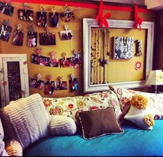 I like the idea of using cork board behind a picture frame and then thumb tacks to hand jewelry from :) And the clothes pins with flowers are adorable!