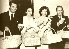 Cary Grant, Rosalind Russell, Myrna Loy and Charles Boyer during a World War II charity drive.