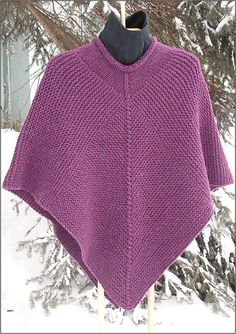Knit in one piece with no sewing. Garter stitch all the way. It's interesting and fun to wear. Work a diamond shape for the front, pick up from the sides of the diamond and knit a rectangle over the shoulders and finish with another diamond on the back. Really Cool.