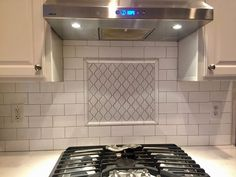 Kitchen backsplash and Cambria countertops installed by Winston Floors + Countertops.