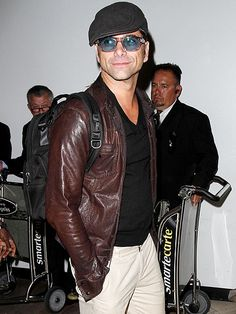 Star Tracks: Wednesday, July 23, 2014   CAP IT OFF   John Stamos arrives back in Los Angeles after a trip to New York City to promote his new film My Man Is a Loser.