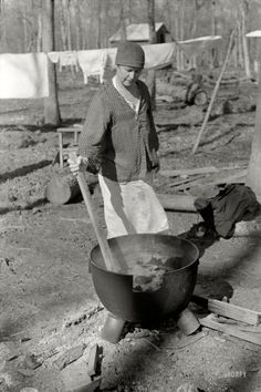 """January 1939. """"Housewife boiling clothes - Chicot Farms, Arkansas."""" Note the primitive nature of this washer -- it doesn't even have a """"simmer"""" setting. 35mm nitrate negative by Russell Lee, Farm Security Administration."""