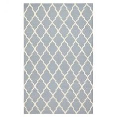 Hand-woven New Zealand wool rug with a quatrefoil trellis motif.    Product: RugConstruction Material: 100% New Zealand blended woolColor: GrayFeatures:  Hand-wovenDhurrie Note: Please be aware that actual colors may vary from those shown on your screen. Accent rugs may also not show the entire pattern that the corresponding area rugs have.Cleaning and Care: These rugs can be spot treated with a mild detergent and water.  Professional cleaning is recommended if necessary.