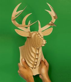 """This is a cardboard deer. It's goofy, I know. My boys are into all things """"outdoors""""- hunting, fishing etc. Thought it would be cool to scatter a few of these on their bedroom wall."""