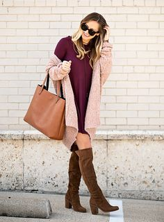An oversized cardigan worn atop a flowy sweater dress makes for the ultimate cozy outfit.