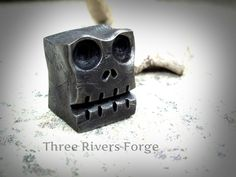 "I had an odd piece of 1"" square stock left over from a project, so I forged it into a skull......"