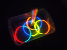 glow in the dark ring toss; tape 3 sticks to a ruler and shove into some play-doh as the goal; toss glow stick necklaces/bracelets at the goal